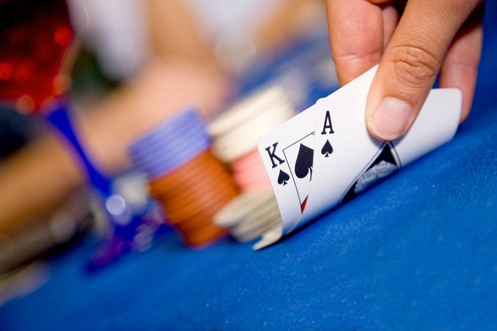 playing cards during a blackjack game with a good hand